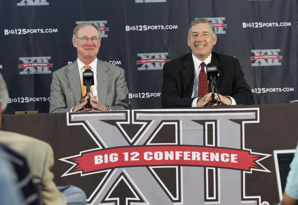 New Big 12 Conference Commissioner Bob Bowlsby, right, smiles at a news conference where he was introduced to the media at Big 12 headquarters Friday, May 4, 2012, in Irving, Texas. At left is Oklahoma State University President Burns Hargis (AP Photo/LM Otero)