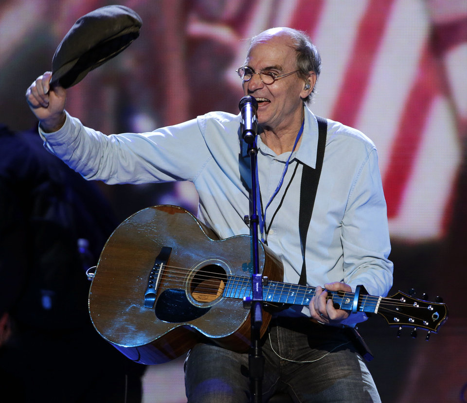 Photo -   Singer songwriter James Taylor waves his hat towards fans after a sound check at the Democratic National Convention in Charlotte, N.C., on Thursday, Sept. 6, 2012. (AP Photo/J. Scott Applewhite)