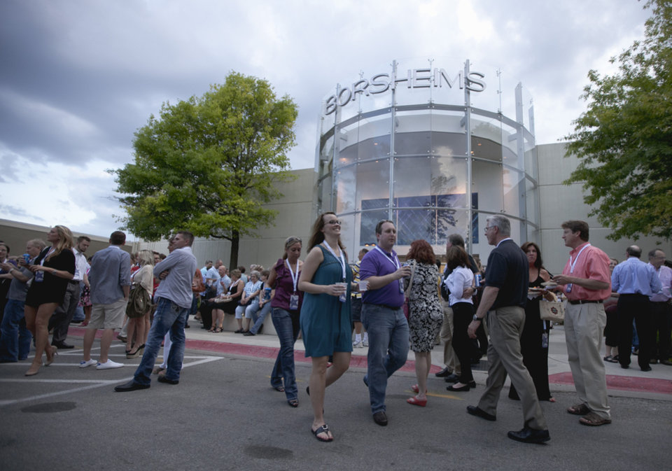 Photo -   Shareholders join a cocktail party outside the Berkshire-owned Borsheims jewelry store in Omaha, Neb., Friday, May 4, 2012. Berkshire Hathaway is expected to have 30,000 shareholders come to Omaha for it's annual shareholders meeting this weekend. (AP Photo/Nati Harnik)