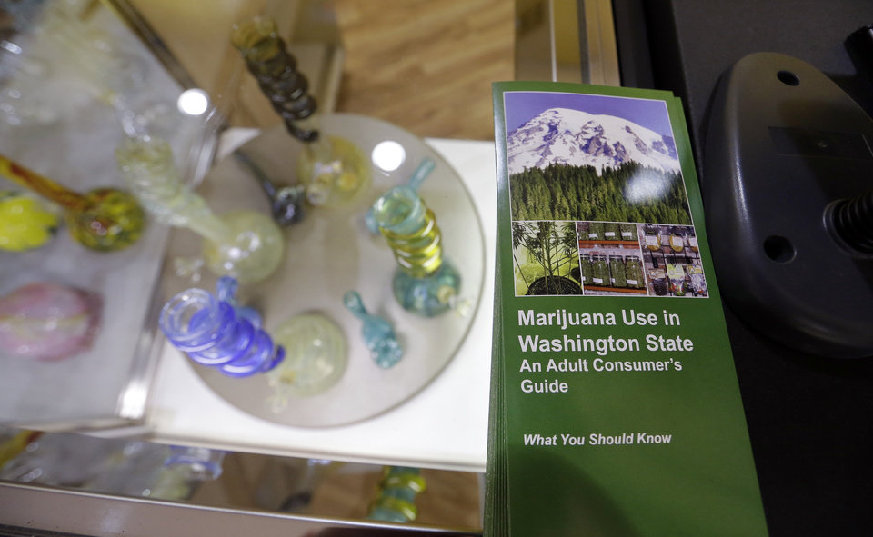 Photo - A consumer's guide to marijuana use, published by the Washington State Liquor Control Board, sits on a counter at the Cannabis City marijuana retail shop days before the grand opening Wednesday, July 2, 2014, in Seattle. Pot is expected to go on sale beginning Tuesday, July 8, the first day that recreational marijuana can legally be sold in Washington state. The shop is expected to be the first licensed retailer in Seattle. (AP Photo/Elaine Thompson)