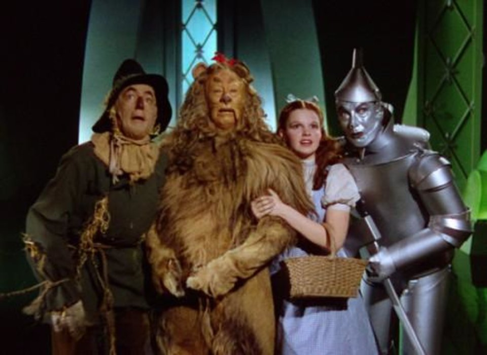 """Photo -  Characters from """"The Wizard of Oz"""" — Scarecrow, Cowardly Lion, Dorothy and Tin Man — are shown in this scene from the classic movie. Photo provided"""