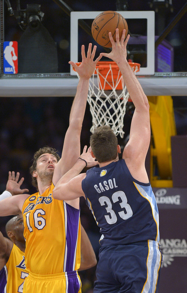 Memphis Grizzlies center Marc Gasol, right, of Spain, shoots over Los Angeles Lakers forward Pau Gasol, of Spain, during the first half of their NBA basketball game, Friday, April 5, 2013, in Los Angeles. (AP Photo/Mark J. Terrill)