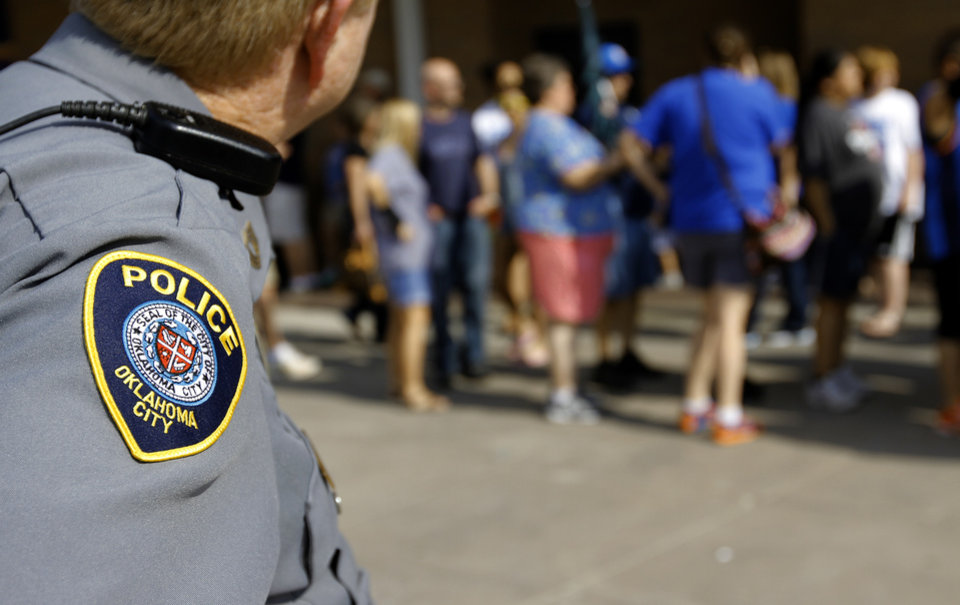 Photo - An Oklahoma City Police officer stands on patrol in Thunder Alley during Game 2 of the NBA Finals between the Oklahoma City Thunder and the Miami Heat at Chesapeake Energy Arena in Oklahoma City, Thursday, June 14, 2012. Photo by Chris Landsberger, The Oklahoman