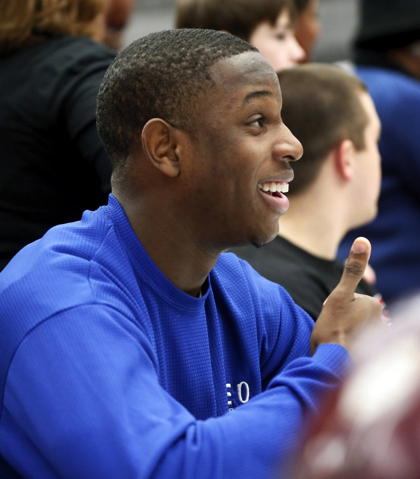 Photo - Ashton Antwine gives a thumbs up during signing day for student athletes at Edmond Memorial High School in Edmond, Okla., Wednesday, Feb. 5, 2014. Antwine signed to play football at NEO. Photo by Nate Billings, The Oklahoman