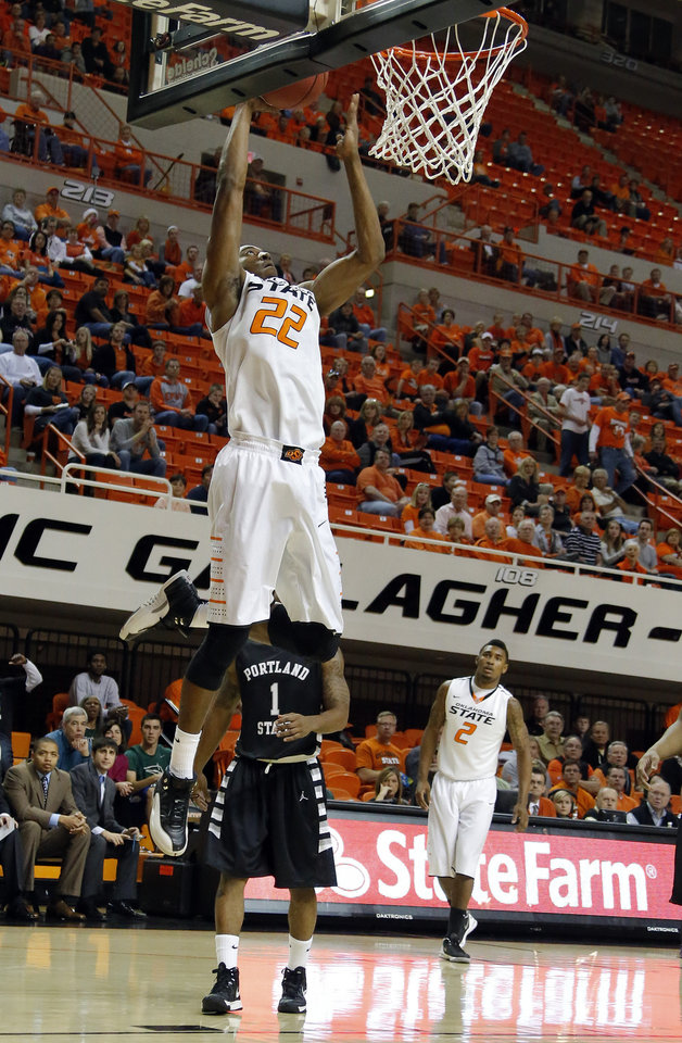 Oklahoma State\'s Markel Brown (22) dunks in front of Portland State\'s Lateef McMullan (1) during the college basketball game between Oklahoma State University and Portland State, Sunday,Nov. 25, 2012. Photo by Sarah Phipps, The Oklahoman