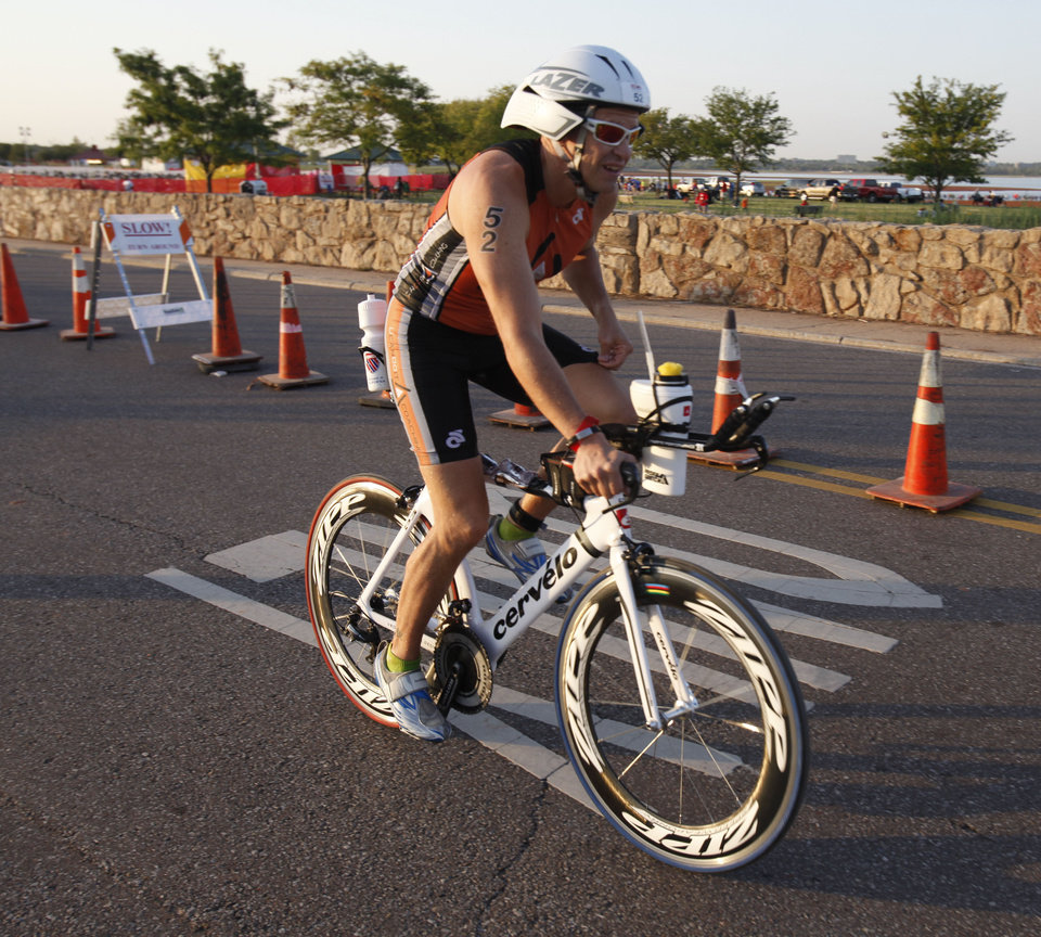 Athlete Christopher Vaughan begins the biking leg of the Redman Triathlon in Oklahoma City, OK, Saturday, September 22, 2012,  By Paul Hellstern, The Oklahoman