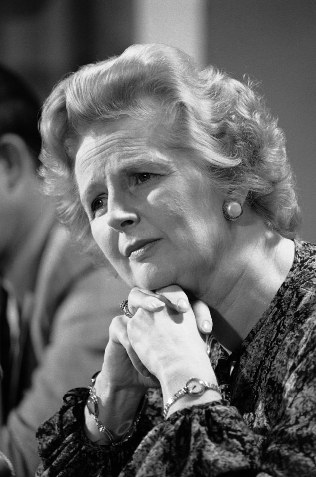 Photo - FILE - In this Sept. 14, 1977 file photo, British Conservative Party Leader Margaret Thatcher listens to a reporters question during a press conference at the British Embassy in Washington. Ex-spokesman Tim Bell says that Thatcher has died. She was 87. Bell said the woman known to friends and foes as