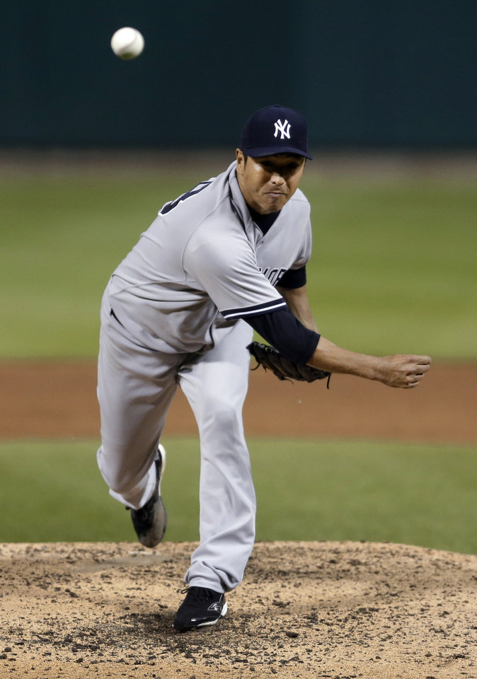 Photo - New York Yankees starting pitcher Hiroki Kuroda throws during the fourth inning of a baseball game against the St. Louis Cardinals on Wednesday, May 28, 2014, in St. Louis. (AP Photo/Jeff Roberson)
