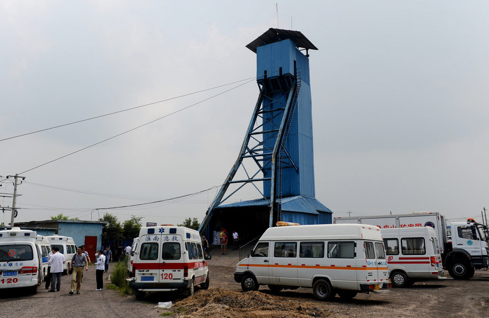 Photo - In this Aug. 19, 2014 photo, ambulances are parked at the Dongfang Coal Mine in Huainan city, east China's Anhui Province, Tuesday, Aug. 19, 2014.  An explosion Tuesday in the coal mine in eastern China trapped 27 workers underground, state media reported. (AP Photo/Xinhua, Zhang Duan) NO SALES