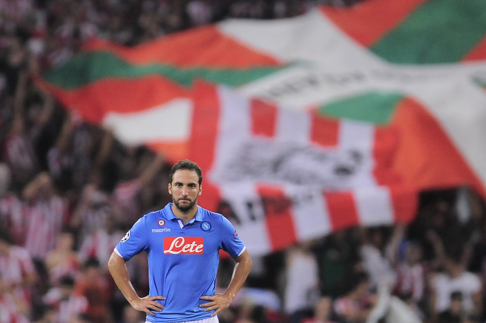Photo - SSC Napoli's Gonzalo Higuain walks from the pitch dejected after his team lost 3-1 against Athletic Bilbao,  during their Champions League playoff second leg soccer match, at San Mames stadium in Bilbao, northern Spain, Wednesday, Aug. 27, 2014.(AP Photo/Alvaro Barrientos)