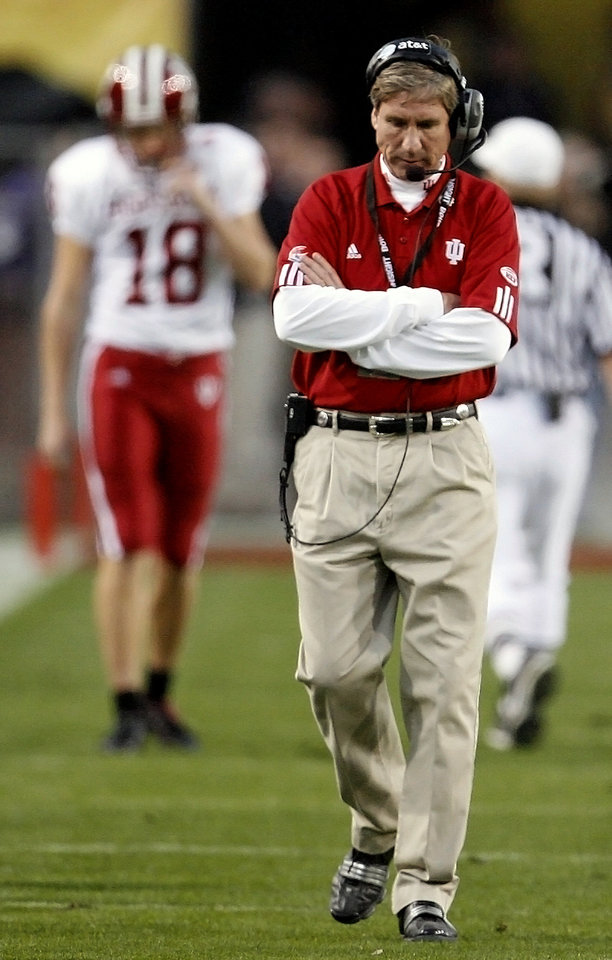 Photo - Indiana coach Bill Lynch hangs his head as he walks the sideline in the first half during the Insight Bowl college football game between Oklahoma State University (OSU) and the Indiana University Hoosiers (IU) at Sun Devil Stadium on Monday, Dec. 31, 2007, in Tempe, Ariz.   BY BRYAN TERRY, THE OKLAHOMAN ORG XMIT: KOD