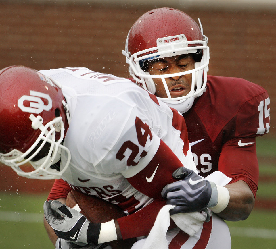 Photo - Dejuan Miller (24) catches a Landry Jones pass in front of Lamar Harris (15) during the spring Red and White football game for the University of Oklahoma (OU) Sooners at Gaylord Family/Oklahoma Memorial Stadium on Saturday, April 17, 2010, in Norman, Okla.  Photo by Steve Sisney, The Oklahoman