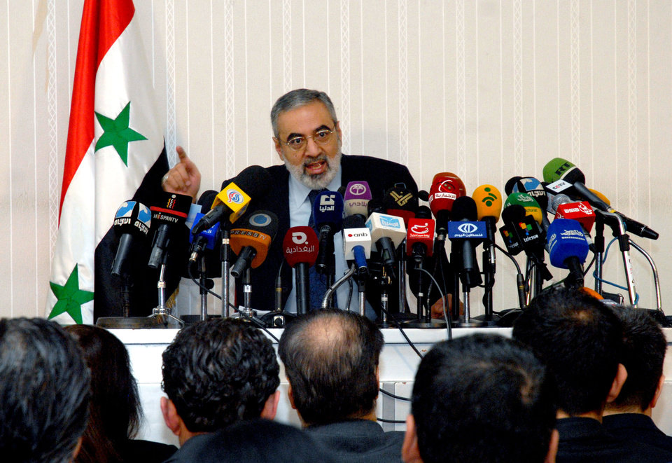 In this photo released by the Syrian official news agency SANA, Syrian Information Minister Omran al-Zoubi speaks during a press conference in Damascus, Syria, Sunday, Dec. 23, 2012. Al-Zoubi said, the Syrian government's line that it is fighting terrorist groups backed by foreign powers who seek to destroy Syria, he equated the rebels with al-Qaida and denied that they had taken over any territory and said the government was willing to engage in dialogue but said the other side wasn't. (AP Photo/SANA)