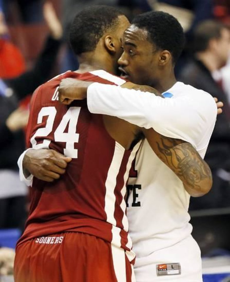 Oklahoma's Romero Osby (24) hugs San Diego State's Jamaal Franklin (21) after a game between the University of Oklahoma and San Diego State in the second round of the NCAA men's college basketball tournament at the Wells Fargo Center in Philadelphia, Friday, March 22, 2013. San Diego State beat OU, 70-55. Photo by Nate Billings, The Oklahoman