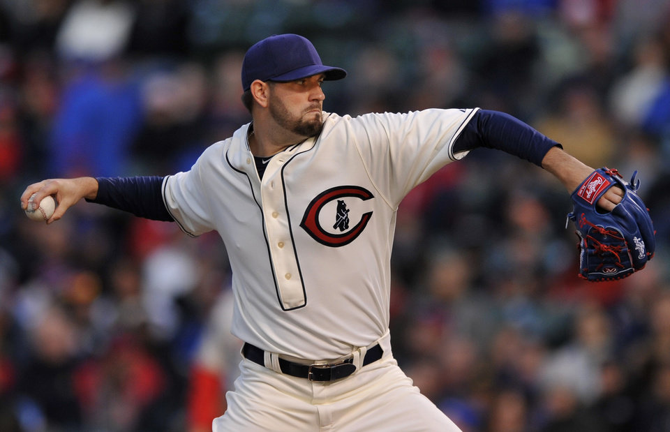 Photo - Chicago Cubs starter Jason Hammel delivers a pitch during the first inning of baseball game against the St. Louis Cardinals in Chicago, Sunday, May 4, 2014. (AP Photo/Paul Beaty)