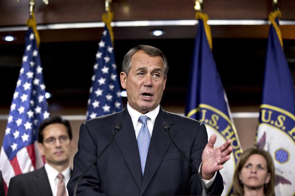 Photo -   Speaker of the House John Boehner, R-Ohio, speaks to reporters after the House Republicans voted for their leadership for the next session of Congress, at the Capitol in Washington, Wednesday, Nov. 14, 2012. He is flanked by Majority Leader Eric Cantor, R-Va., left, and Rep. Lynn Jenkins, R-Kan., right. (AP Photo/J. Scott Applewhite)