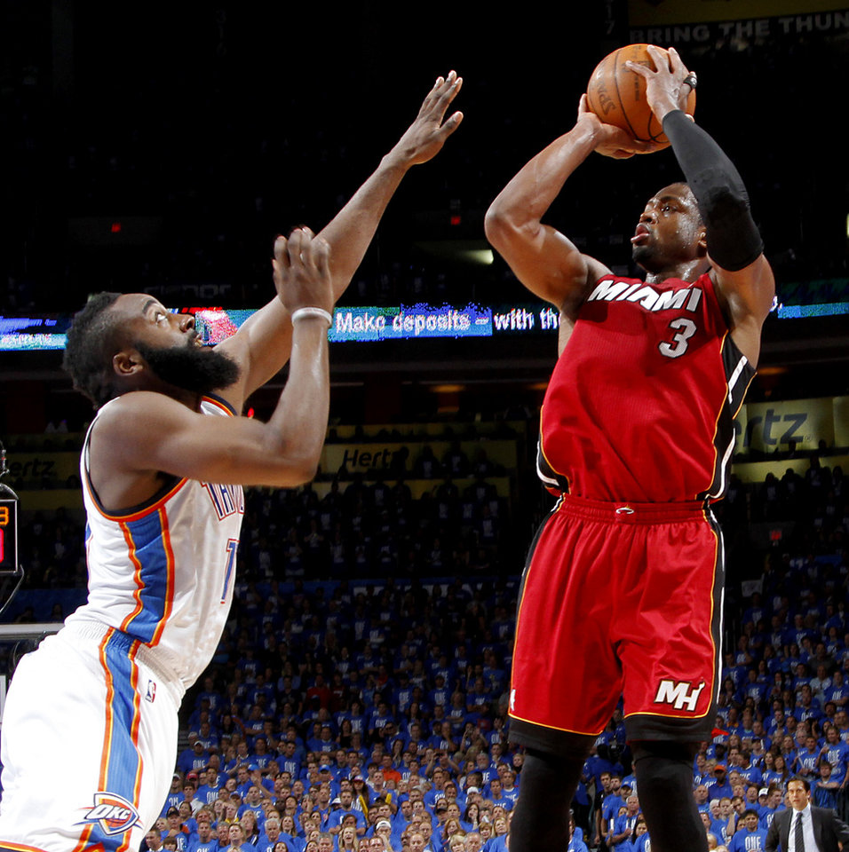 Miami's Dwyane Wade (3) shoots over Oklahoma City's James Harden (13) during Game 1 of the NBA Finals between the Oklahoma City Thunder and the Miami Heat at Chesapeake Energy Arena in Oklahoma City, Tuesday, June 12, 2012. Photo by Chris Landsberger, The Oklahoman
