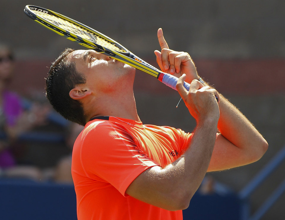 Photo -   Spain's Nicolas Almagro reacts after winning his match against Jack Sock in the third round of play at the 2012 US Open tennis tournament, Saturday, Sept. 1, 2012, in New York. (AP Photo/Paul Bereswill)