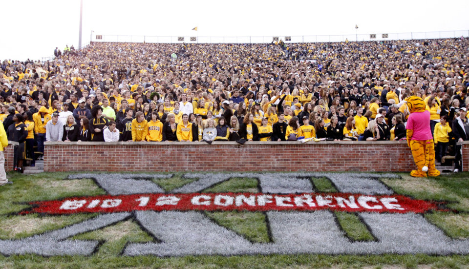 FILE - In this Sept. 17, 2011 file photo, a Big 12 Conference logo is shown during the first quarter of an NCAA college football game between the Missouri and the Western Illinois in Columbia, Mo. Missouri has taken another step toward leaving the Big 12 Conference and there is interest in the SEC in taking the Tigers. The governing curators at Missouri unanimously gave Chancellor Brady Deaton the authority Friday, Oct. 21, 2011, to move the school out of the Big 12 if he decides that is in the school\'s best interest. He gave no timeline for a decision but indicated that a move, if it happens, would not take much longer. (AP Photo/Jeff Roberson, File) ORG XMIT: NY157