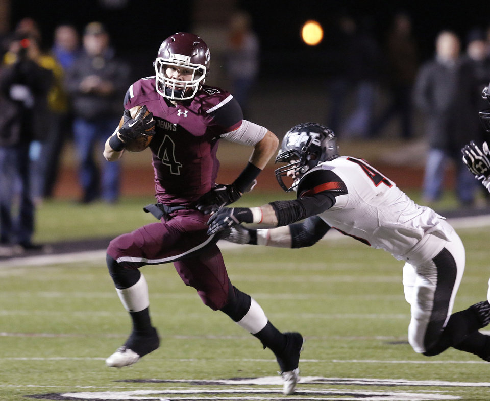 Photo - Jenks (4) Dylan Harding outruns Westmoores Kiante Channel (4) during the 6A high school playoff game between Westmoore and Jenks at Yukon High School Friday November 29, 2013. Photo by Doug Hoke, The Oklahoman