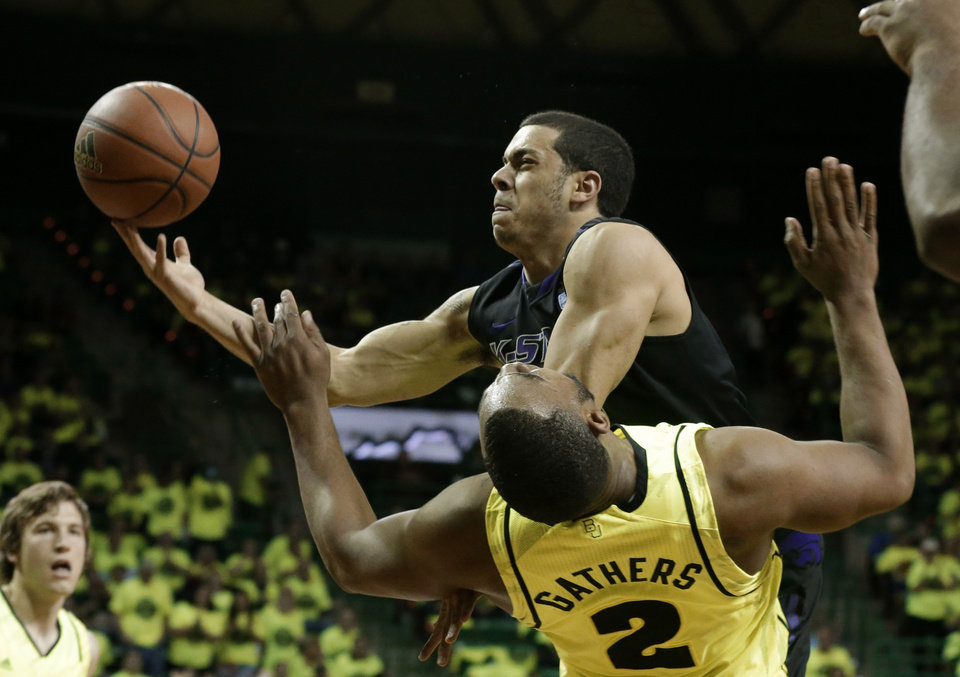 Baylor\'s Rico Gathers (2) takes a charge to the basket by Kansas State\'s Angel Rodriguez in the first half of an NCAA college basketball game on Saturday, March 2, 2013, in Waco, Texas. (AP Photo/Tony Gutierrez)