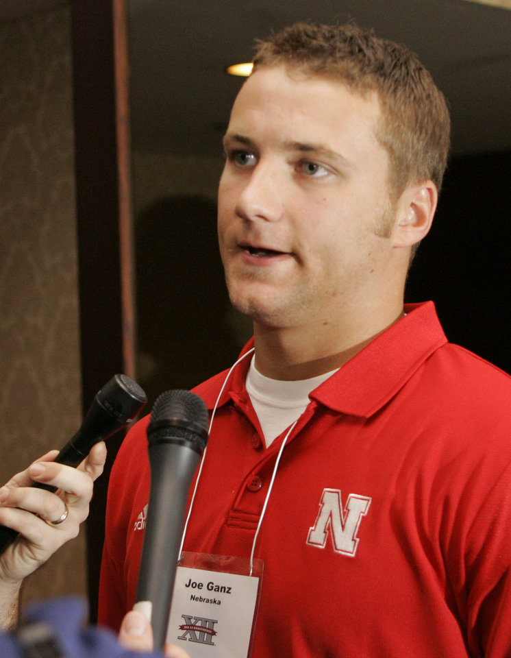 Photo - University of Nebraska college football quarterback Joe Ganz answers reporters questions during Big 12 Media Days in Kansas City, Mo., Monday, July 21, 2008. (AP Photo/Orlin Wagner) ORG XMIT: MOOW103