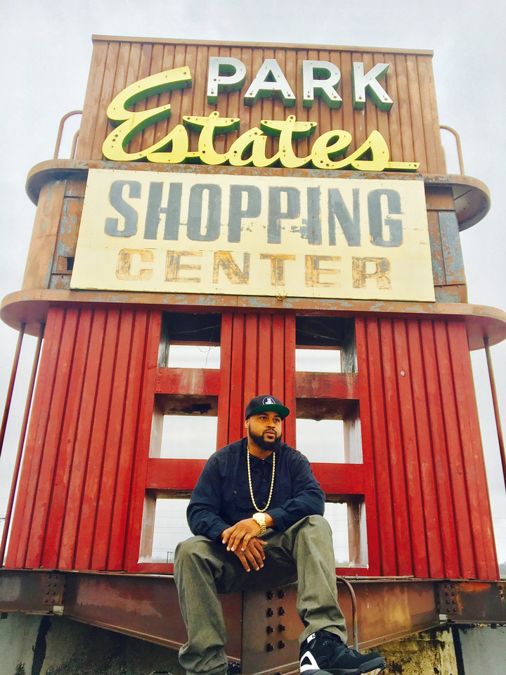 Photo - Big Kemp (Chris Kemp) posing at the shopping center near to where he grew up. [Photo provided]