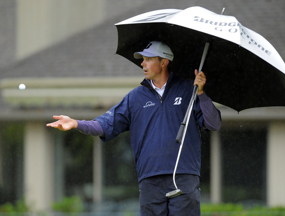 Photo - Matt Kuchar flips his ball to his caddy on the fifth green during the second round of the RBC Heritage golf tournament in Hilton Head Island, S.C., Friday, April 18, 2014. (AP Photo/Stephen B. Morton)