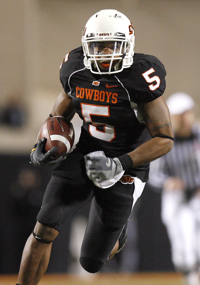 Photo - OSU's Keith Toston (5) runs on the way to a touchdown during the college football game between Oklahoma State University (OSU) and the University of Colorado (CU) at Boone Pickens Stadium in Stillwater, Okla., Thursday, Nov. 19, 2009. Photo by Sarah Phipps, The Oklahoman