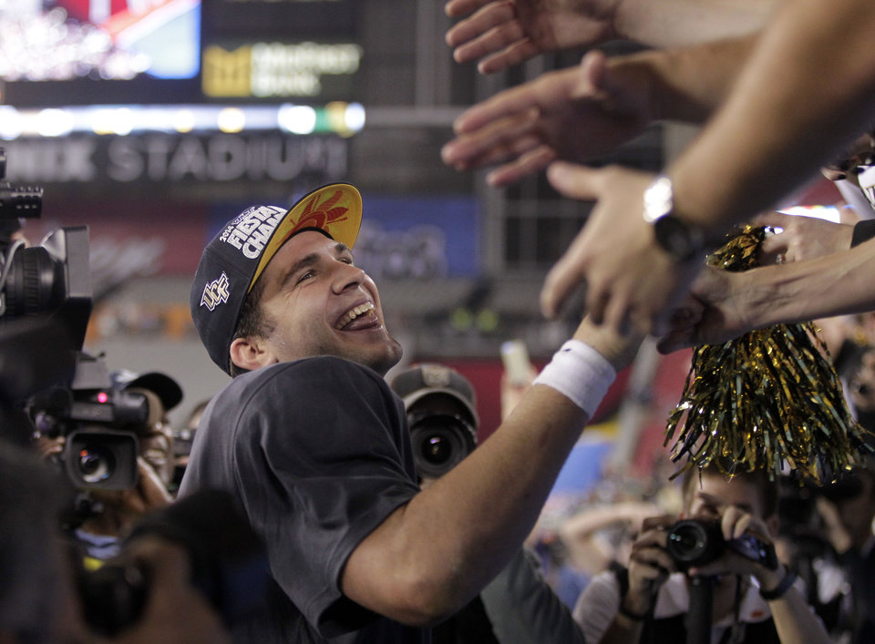 Central Florida quarterback Blake Bortles greets fans after the Fiesta Bowl NCAA college football game against Baylor, Wednesday, Jan. 1, 2014, in Glendale, Ariz. Central Florida won 52-42. (AP Photo/Rick Scuteri)