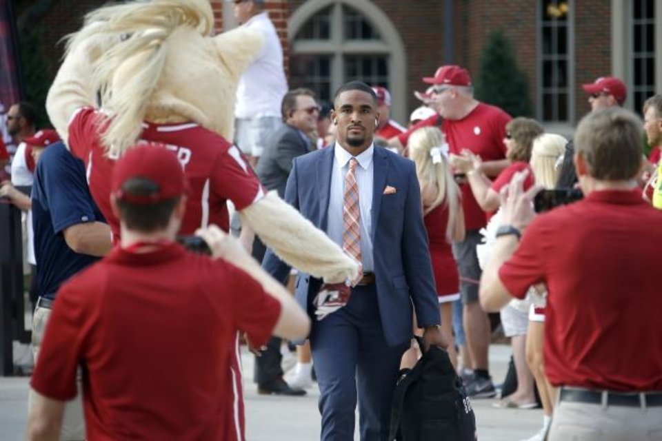 Photo -  Oklahoma quarterback Jalen Hurts, center, walks toward Owen Field before the Sooners' Sept. 28 game against Texas Tech. [Bryan Terry/The Oklahoman]