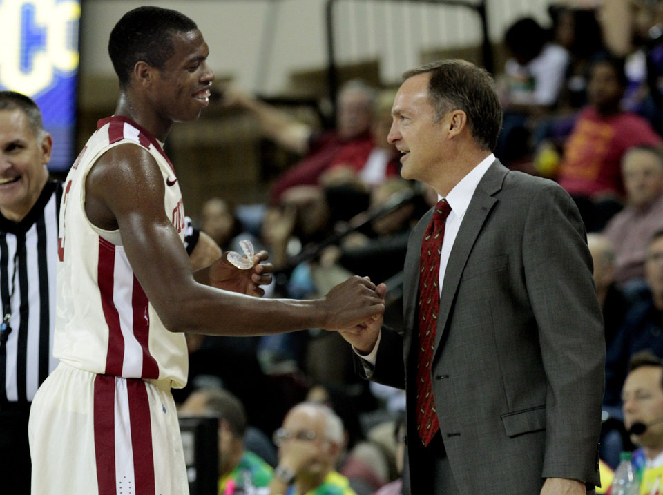 Oklahoma head coach Lon Kruger shakes hands with his leading scorer Buddy Hield as the University of Oklahoma (OU) Sooners men's basketball team defeats  the Central Oklahoma Bronchos 94-66 at McCasland Field House on Wednesday, Nov. 7, 2012  in Norman, Okla. Photo by Steve Sisney, The Oklahoman