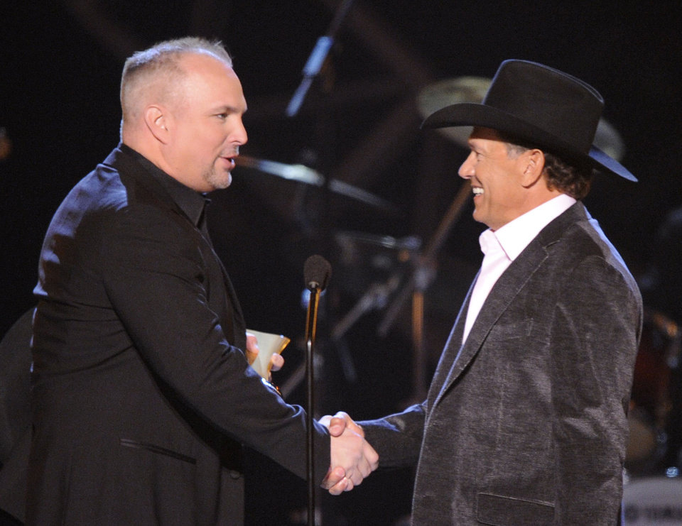 Garth Brooks presents George Strait with the Artist of the Decade award at the 2009 ACM Artist of the Decade All Star Concert in Las Vegas. Brooks and Strait will perform together for a tribute to the late Dick Clark at the 48th Annual Academy of Country Music Awards. AP File Photo