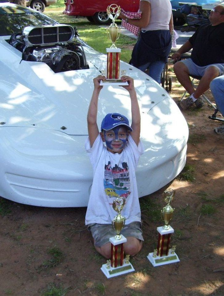Garrett Hirzel displays the trophies his family won at the Flashback's Car Show at Mineral Wells Park in Guthrie 9/15/07<br/><b>Community Photo By:</b> Martin B.<br/><b>Submitted By:</b> Jimmy, Guthrie