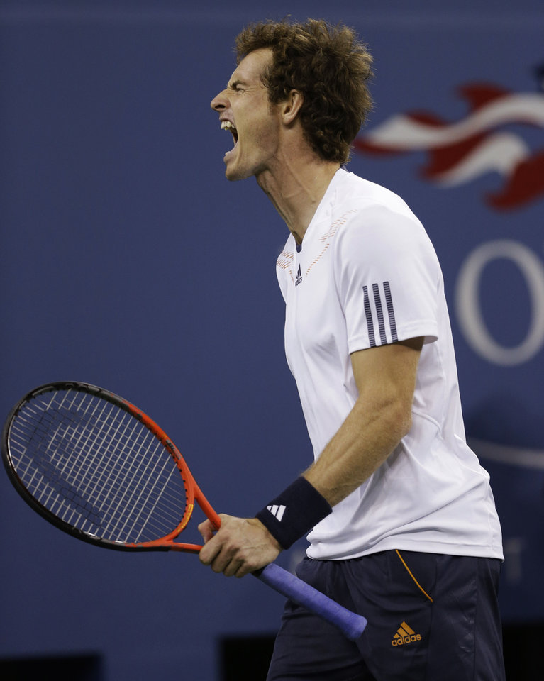 Photo -   Britain's Andy Murray reacts while playing against Serbia's Novak Djokovic during the championship match at the 2012 US Open tennis tournament, Monday, Sept. 10, 2012, in New York. (AP Photo/Darron Cummings)