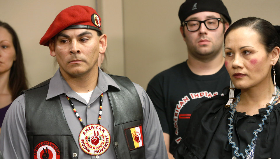 Photo -  At left, wearing beret, is Michael Casteel with the Seminole Nation. He is from Tecumseh and is the director of American Indian Movement. With him is Ashley McCray, from Norman. She is a member of the Absentee Shawnee Tribe. [Photo by Jim Beckel, The Oklahoman]
