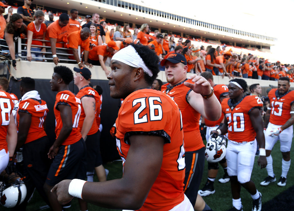 Photo - Oklahoma State's Barry J. Sanders (26) leaves the field following the college football game between the Oklahoma State Cowboys (OSU) and the Southeastern Louisiana Lions at Boone Pickens Stadium in Stillwater, Okla., Saturday, Sept. 12, 2015. Photo by Sarah Phipps, The Oklahoman