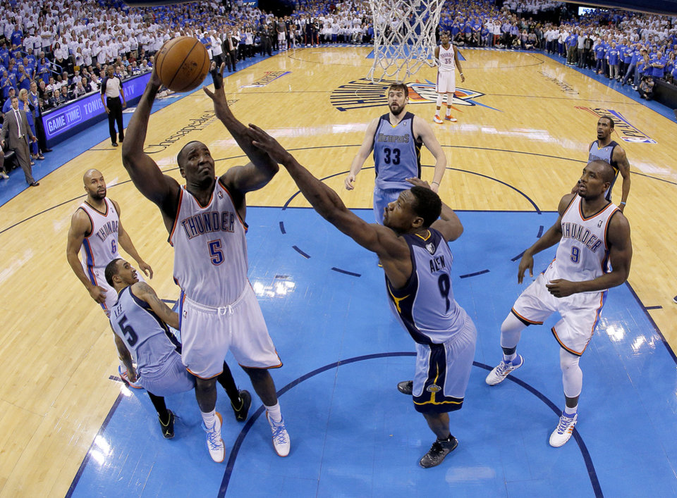 Photo - Oklahoma City's Kendrick Perkins (5) makes a basket as Memphis' Tony Allen (9) defends to send the game into overtime in during Game 2 in the first round of the NBA playoffs between the Oklahoma City Thunder and the Memphis Grizzlies at Chesapeake Energy Arena in Oklahoma City, Monday, April 21, 2014. Photo by Sarah Phipps, The Oklahoman