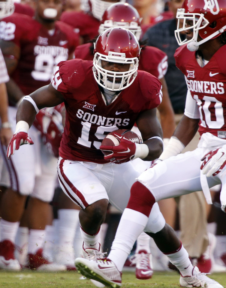 Photo - Oklahoma Sooners's Eric Striker (19) intercepts a pass during a college football game between the University of Oklahoma Sooners (OU) and the Louisiana Tech Bulldogs at Gaylord Family-Oklahoma Memorial Stadium in Norman, Okla., on Saturday, Aug. 30, 2014. Photo by Steve Sisney, The Oklahoman