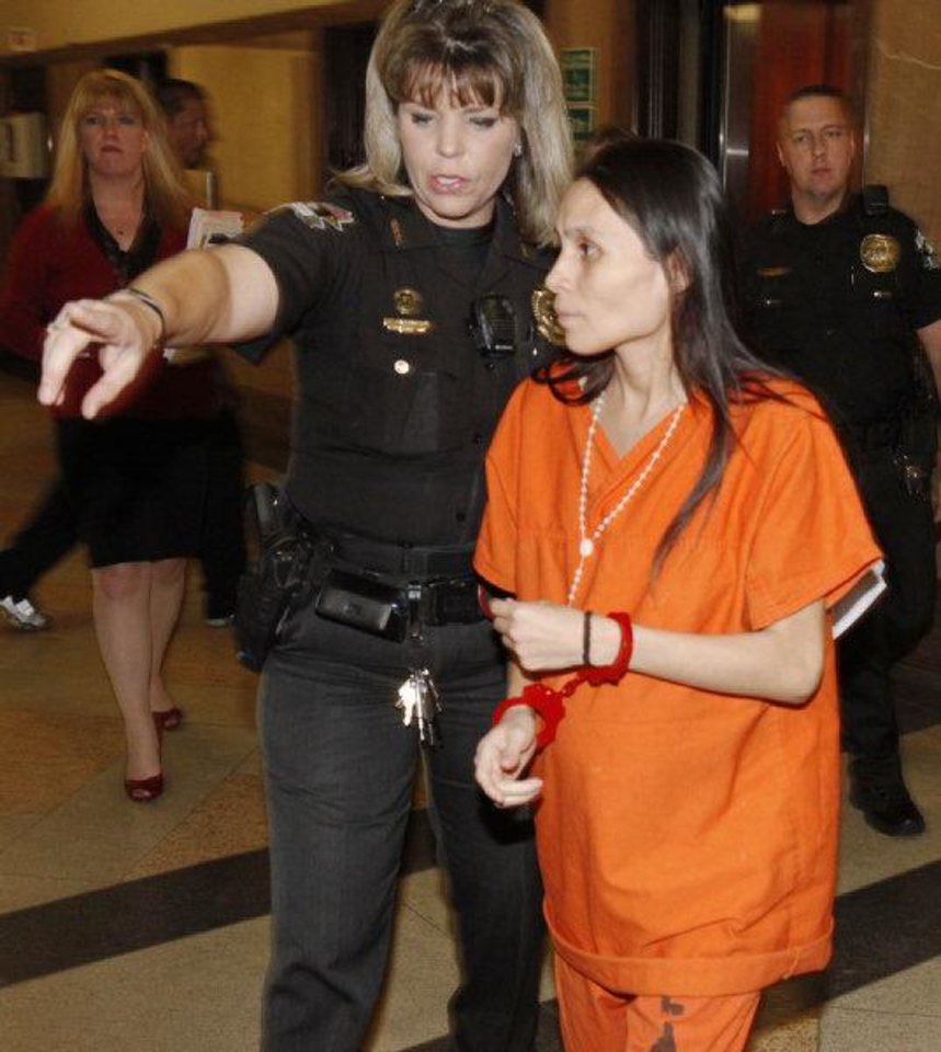 An Oklahoma County sheriff's deputy guides Aesusena Gonzales to a courtroom Tuesday in Oklahoma City. Photo by Paul Hellstern, The Oklahoman