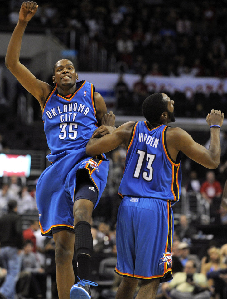 Photo - L.A. CLIPPERS / CELEBRATION: Oklahoma City Thunder forward Kevin Durant, left, celebrates with guard James Harden after scoring the winning basket against the Los Angeles Clippers during the second half of their NBA basketball game in Los Angeles, Wednesday, Nov. 11, 2009. The Thunder won 83-79. (AP Photo/Chris Carlson) ORG XMIT: LAS107