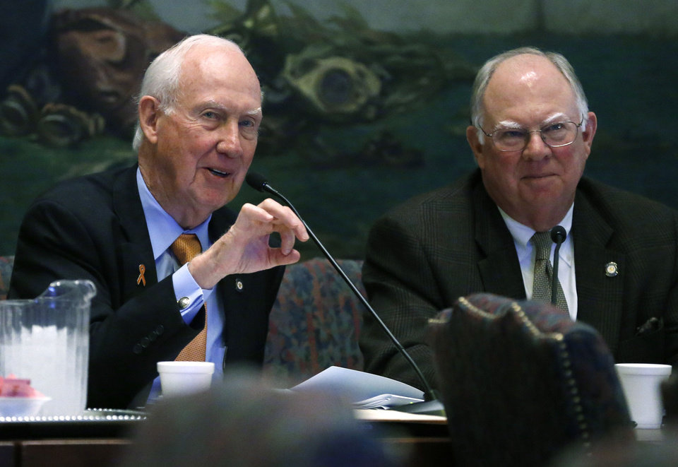 Photo - Oklahoma state Sen. James Halligan, left, R-Stillwater, gestures as he asks a question during a joint legislative budget committee meeting in Oklahoma City on Jan. 24. Oklahoma state Sen. John Ford, R-Bartlesville, looks on at right. AP Photo  Sue Ogrocki