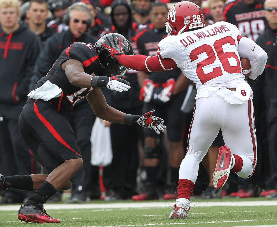 Oklahoma's Damien Williams tries to get past Texas Tech's D.J. Johnson during an NCAA college football game in Lubbock, Texas, Saturday, Oct. 6, 2012. (AP Photo/Lubbock Avalanche-Journal, Stephen Spillman) LOCAL TV OUT