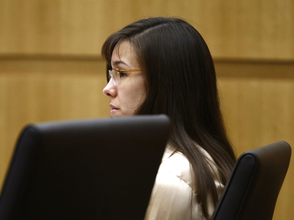 Photo - Jodi Arias listens to prosecutor Juan Martinez address  the jury on Wednesday, May 15, 2013, during the sentencing phase of her trial at Maricopa County Superior Court in Phoenix. If the jury finds aggravating factors in her crime, Arias could be sentenced to death. Jodi Arias was convicted of first-degree murder in the stabbing and shooting  death of Travis Alexander in his suburban Phoenix home in June 2008. (AP Photo/The Arizona Republic, Rob Schumacher, Pool)
