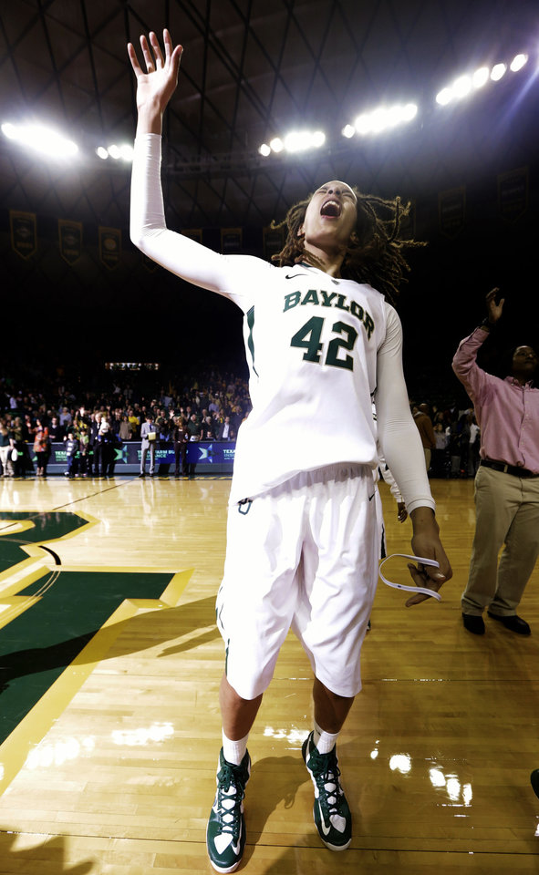 Photo - Baylor's Brittney Griner (42) celebrates after their 82-65 win over Oklahoma in an NCAA college basketball game, Saturday, Jan. 26, 2013, in Waco Texas. Griner broke the NCAA women's career record for blocks. (AP Photo/LM Otero) ORG XMIT: TXMO108