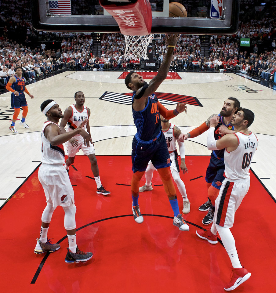 Photo - Oklahoma City Thunder forward Paul George, center, shoots against the Portland Trail Blazers during the first half of Game 5 of an NBA basketball first-round playoff series, Tuesday, April 23, 2019, in Portland, Ore. (AP Photo/Craig Mitchelldyer)