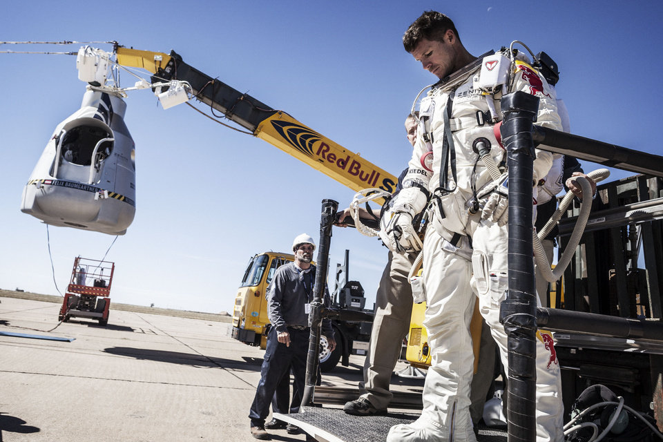 In this photo provided by Red Bull Stratos, pilot Felix Baumgartner of Austria leaves his capsule after his mission was aborted due to high winds during the final manned flight of Red Bull Stratos in Roswell, N.M., Tuesday, Oct. 9, 2012. (AP Photo/Red Bull Stratos, Balazs Gardi)