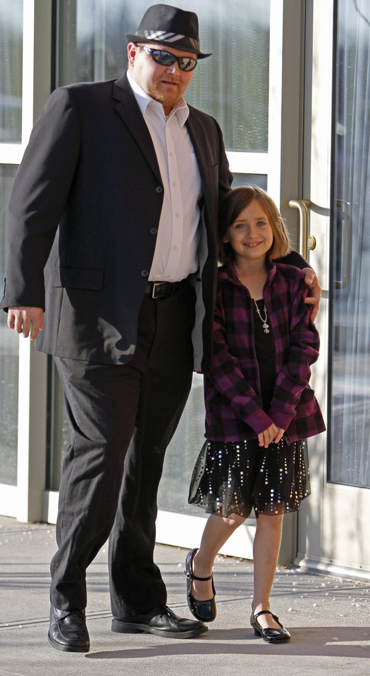 Ronnie Smith and daughter Gina, 8, arrive for the annual Daddy Daughter Dance sponsored by the city's Parks and Recreation Department at the Embassy Suites hotel on Saturday, February 5, 2011, in Norman, Okla.   Photo by Steve Sisney, The Oklahoman