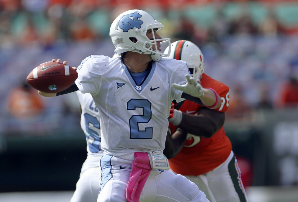 North Carolina's quarterback Bryn Renner (2) passes during the first half of an NCAA college football game in Miami, Saturday, Oct. 13, 2012 against Miami. (AP Photo/J Pat Carter)