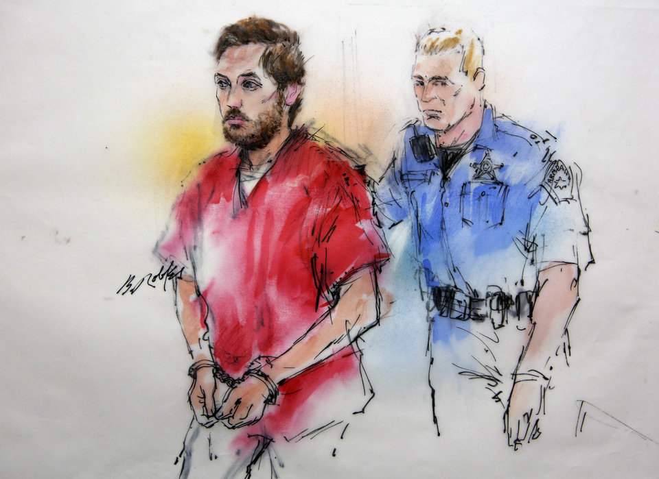Photo - This courtroom sketch shows James Holmes being escorted by a deputy as he arrives at preliminary hearing in district court in Centennial, Colo., on Monday, Jan. 7, 2013. Investigators say Holmes opened fire during the midnight showing of the latest Batman movie on July 20, killing 12 people and wounding dozens. (AP Photo/Bill Robles, Pool) TV OUT